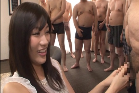 Smiling Japanese woman inspects juice men