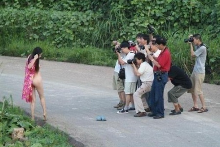 Japanese men taking picture of naked women outside