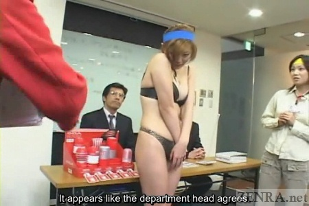 Embarrassed Japanese woman in lingerie in office